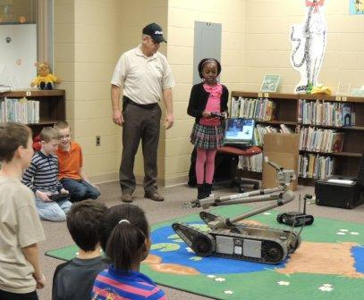 A Partridge Elementary student demonstrates her ability to maneuver a robot.