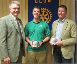 Rotary Club President David Lowe presents a Rotary mug to Dr. Curt Elmore and thanks him and Matt Simon for speaking to the club about their research.
