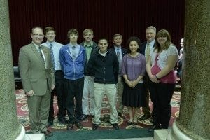 Left to right, Rep. Steve Lynch, Jon Lowe, Devin Shultz, Dallas Ernst, Ryan Flores, Rotarian Randy Becht, Brianna Ellerby, Rotarian David Lowe and Lia Edwards.