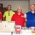 Members of the Rotary Club of Bolivar assist at Community Outreach Ministries in Bolivar, an affiliate of Ozarks Food Harvest in Springfield. Left to right are Charlotte Marsch, Neal DeShazo, Pat Douglas, Bob Ham and Ed Kurtz.