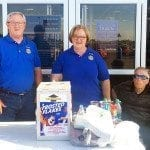 "Butler Rotary ""food fight"" chair, Larry Hacker, and President Kay Caskey and her husband, former Missouri Senator Harold Caskey, collect food outside WalMart for the Bates County Food Pantry."