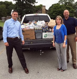 Officers of the Rotary Club of Clinton load up 1,643 pounds of food the club collected for their local food bank. Left to right are Kyle Adkins, president; Jesse Alldredge, vice president; and Parker Mills, secretary.