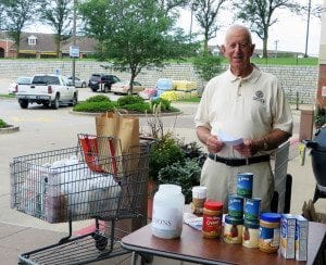 Bob Sfreddo of the Jefferson City Breakfast Rotary Club collects food and monetary donations outside HyVee.
