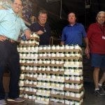 Lake Ozark Rotarians (left to right) Steve Herman, Clint Ladouceur, Kevin Wood and Tom Walker unload cartons of canned goods at Hope House in Eldon.
