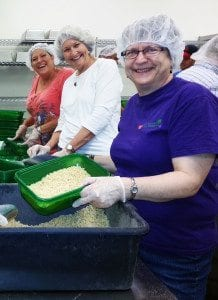 Columbia Metro Rotary members, (front to back) Sarah Read, Jan Becket and Sherry Major, help out at the Food Bank of Central and Northeast Missouri. The club had 27 volunteer hours