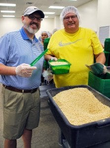Rotary presidents Todd White of Columbia Sunrise Southwest and Charlie Anderson of Fulton help out at the food bank.