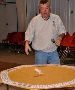 Tom Jones demonstrates mouse roulette before last year's mouse races.