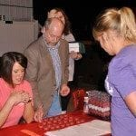 Alaina Leverenz places her bets with Brandy Reagan and Bob Hansen.