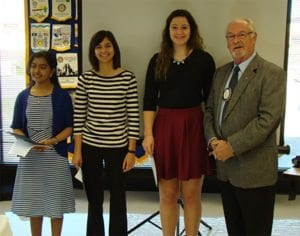 Club President, Bob Asahl, presenting the scholarships to (l to r) Srikavi Premanth and Emily Scully of Jefferson City High School and Olivia Johanns of Helias Catholic High School.