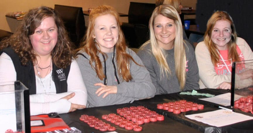 Hannah Mansell, Hope Wallace, Mallory York, Emily Gast, members of the Rotaract Club of William Woods University, work the betting table at last year's event.