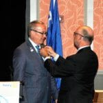 Larry Lunsford pins the Past District Governor's pin on David Bixler.