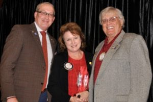 David Bixler presents Rotarian of the Year award to Susan Hart with assistance from Raymond Plue